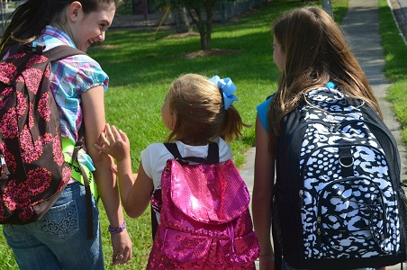 girls wearing backpacks